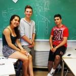 Danah, Matt and Nikita drawing Ms. G on a giraffe.