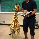 Ishan teaching a calculus lesson to giraffe. He is perplexed.